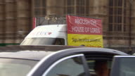 A van driving through Westminster with a banner displaying the words 'Abolish the House of Lords' on the side