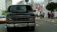MS TU REAR POV Van speeding through town hitting nearby cars