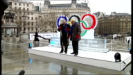 Ice sculpture unveiled in Trafalgar square Boris Johnson along / Johnson and Jim Wright putting on red mittens with Olympics Rings logo and along to...