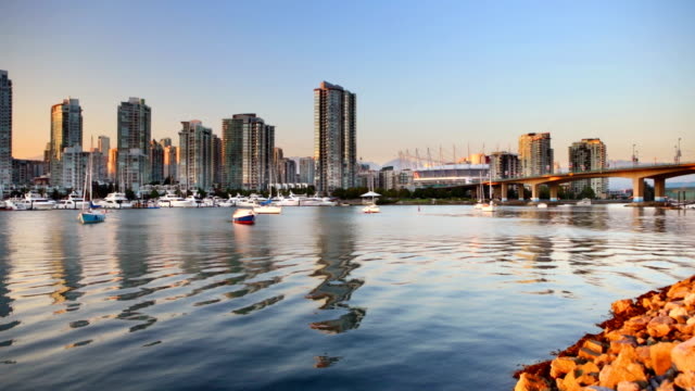 Vancouver, British Columbia, Canada skyline across the water at sunset