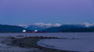 Vancouver Spanish Sunrise Timelapse with two anchored cargo ships in the distance