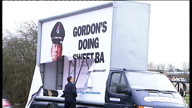 EXT Vandalised Conservative Party billboard on side of van featuring picture of Gordon Brown MP with slogan 'Gordon's Doing Sweet BA' Amsterdam...