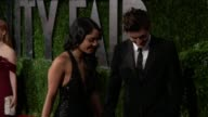 Vanessa Hudgens and Zac Efron at the 2010 Vanity Fair Oscar Party Hosted By Graydon Carter at West Hollywood CA