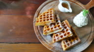 Vanilla ice cream and waffle in  wood plate