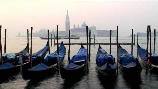 MS Vapporettoes moving past moored gondolas, San Giorgio Maggiore in background, Venice, Veneto, Italy