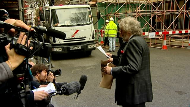 Variant CJD petition handed in to Downing Street ENGLAND London 10 Downing Street EXT **Background noise from construction site interferes with some...