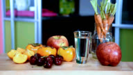 Variety fruits, glass of water on table/ healthy lifestyle conceptual