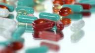 variety of pills on turning mirror - very close