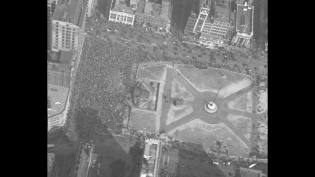 Various aerial shots of crowd of Communist Party members celebrating May Day in Union Square / Note exact year not known