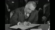Various angles of Dean Acheson speaking with United Nations representatives at signing of Bretton Woods Monetary Agreement / Dean Acheson shaking...