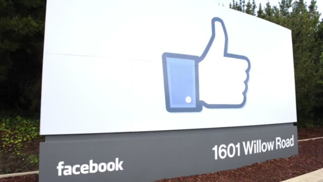 Various angles of signage at Facebook Headquarters / Thumbs Up Like sign / tourists taking photos in front of sign Facebook HQ Signage on April 13...