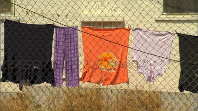 Resultado de imagem para clothes hanging on fence