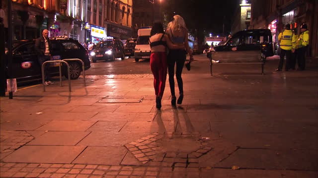 CLEAN Various drunks night clubbers and binge drinking on the streets of Manchester and Newcastle includes people being arrested for Anti social...