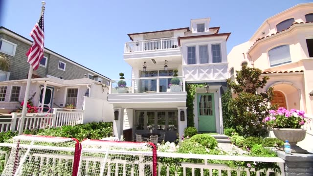 Various exterior shots of real estate in Manhattan Beach California on a clear sunny day A wide shot of a modern Manhattan Beach house with a...