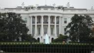 Various exteriors of the White House / tourists taking photos / rainy weather / fall season White House Fall Season on November 10 2011 in Washington...