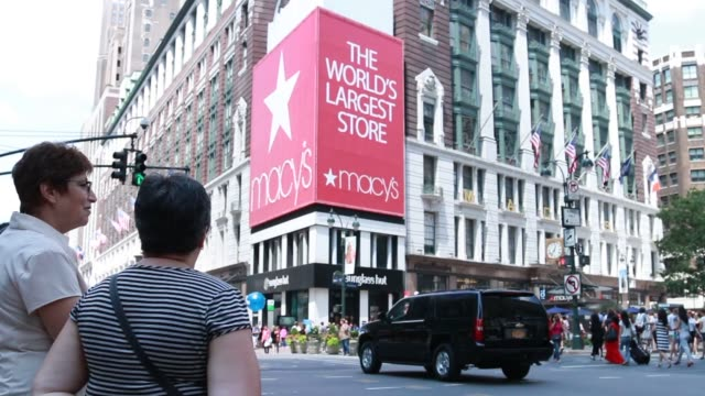Various exteriors shots of the flagship 34th street Macys location in Manhattan New York on a sunny day A wide shot of the exterior of Macys as...