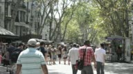 Various general views pedestrians walk down Las Ramblas on a sunny summer day in Barcelona Spain on Thursday July 24 Customers sit eating and...