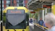 Various general views trams passengers and platforms at the MediaCityUK Metrolink station part of the Metrolink light rail system in Salford Greater...