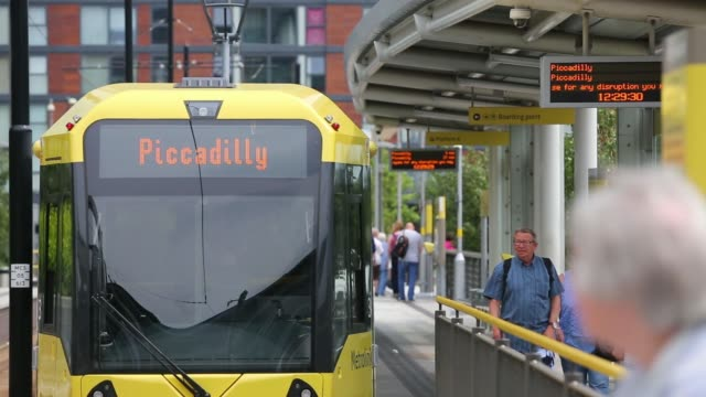 Various general views trams passengers and platforms at the MediaCityUK Metrolink station part of the Metrolink light rail system in Salford Greater...