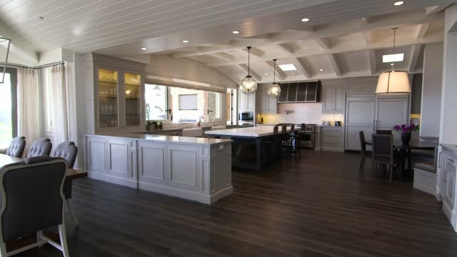 Various interior shots of luxury homes and furnishings in Manhattan Beach California Wide panning shots of a modern luxurious kitchen and dining room...