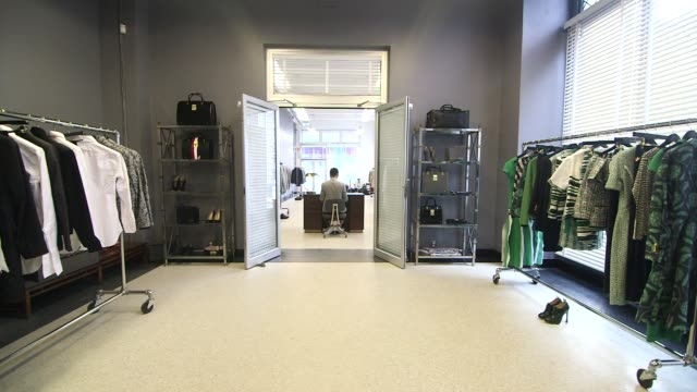 Various interior shots of the Thom Brown Retail Store in New York City New York A wide shot from the back room to the main floor A medium shot of the...