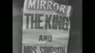 Various newspapers addressing abdication crisis in Great Britain 'The King wants to marry Mrs Simpson Cabinet advises 'no'' / placard 'The King...