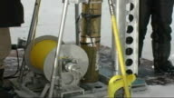 Various of scientists drilling ice cores from Quelccaya ice cap