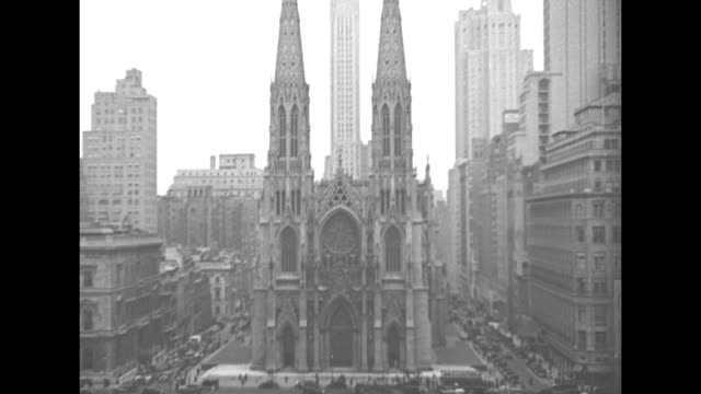 Various overhead shots of Cathedral at time of construction of Rockefeller Center across street / street level shots of Cathedral / shot of Cathedral...