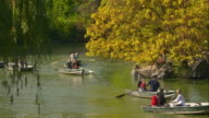 Various people paddle boating in Central Park