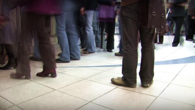Various people queue