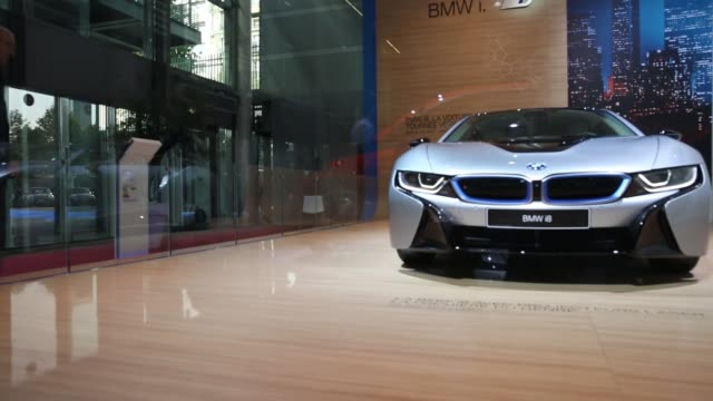 Various shots a BMW i8 hybrid automobile sits on display at the Bayerische Motoren Werke AG stand during the first preview day at the Paris Motor...