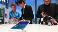 Various shots a Samsung Electronics Co Galaxy Note Edge smartphone sits on display at the company's stand at the IFA International Consumer...