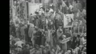 Various shots crowded convention floor signs supporting Douglas MacArthur and large photograph of Abraham Lincoln and signs of state names / MS...