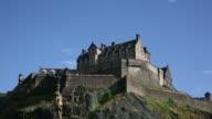 Various shots Edinburgh Castle stands on Castle Rock in Edinburgh UK on Saturday Aug 9 Tourists walk through a park below Edinburgh Castle A statue...