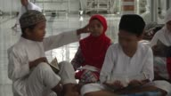Various shots from Indonesian children reading verses of Quran during a recitation at mosques in Banda Aceh district of Aceh Indonesia on June 05...