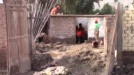Various shots from the tents set up with the help of volunteers and authorities in the Huachipa district east of Lima on March 23 2017 Authorities in...