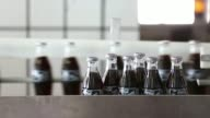 Various shots glass bottles of Coca Cola Light also known as diet Coke move along the production line after filling at the Lanitis Bros Ltd bottling...