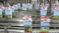 Various shots milk cartons pass along the production line at the Imlek AD dairy plant in Belgrade Serbia on Wednesday Sept 24 A worker monitors milk...