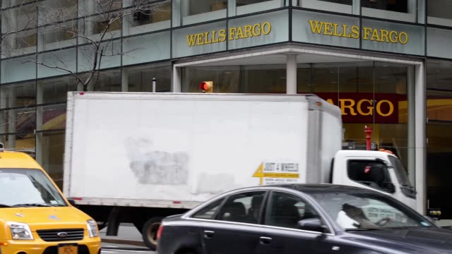 Various shots of a Wells Fargo branch in New York City on April 9 A wide shot of a Wells Fargo branch with traffic passing by Medium shots of a Wells...