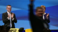Various shots of Angus Robertson taking to the stage at the SNP conference in Aberdeen