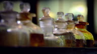 Various shots of antique bottles of arsenic and poison