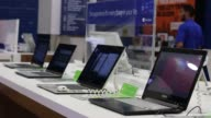 Various shots of back to school shopping at a Best Buy retail location in Manhattan New York A medium shot of laptops on display at a Best Buy A...