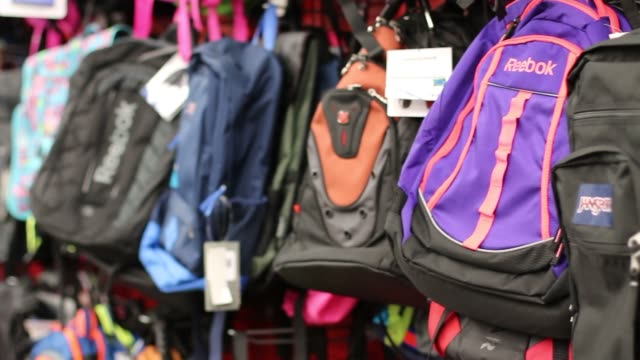 Various shots of back to school shopping at a Staples retail location in Manhattan New York A medium panning shot of a backpack display A medium shot...