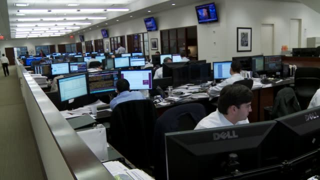 Various shots of BlackRock Financial Professionals working on the floor at their headquarters in New York City A wide panning shot of financial...