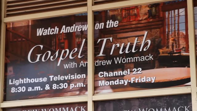 Various shots of Christian bookstore featuring Andrew Wommack and 'Watch Andrew on the Gospel Truth'