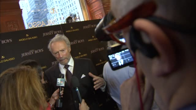 Various shots of Clint Eastwood being interviewed by reporters on the red carpet at the premiere of the Jersey Boys film in New York City