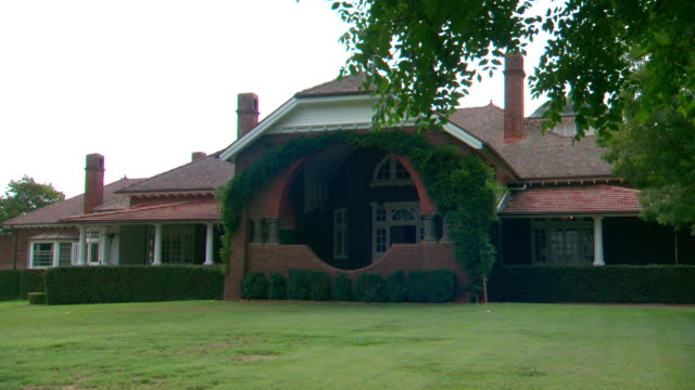 Various shots of exterior of Petersen's Guest House Armidale including homestead garden bench seat under trees on lawn beautiful trees hedge paddocks...