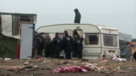 Various shots of French riot police moving in and removing migrants from the 'Jungle' camp in Calais which is being razed