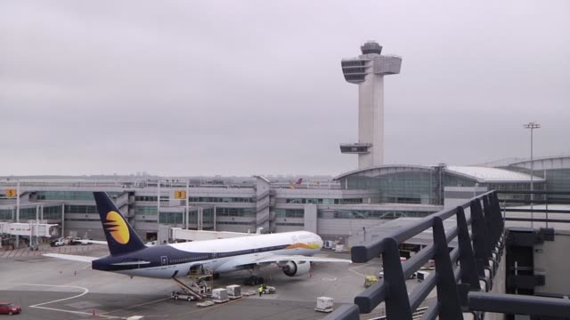 Various shots of Jet Airways airplanes at JFK Airport in New York New York A wide shot of a Jet Airways airplane sitting parked at a gate with the...