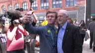 Various shots of Labour leader Jeremy Corbyn posing for 'selfies' with students during a campaign visit to Leeds City College on May 10 2017 in Leeds...